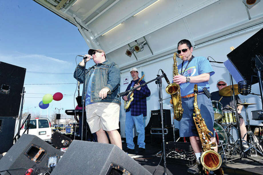 Dr. Andrew Parker, Dr. Richard Frank and the Do Not Resuscitate Band play at Calf Pasture Beach Saturday. / (C)2013, The Hour Newspapers, all rights reserved