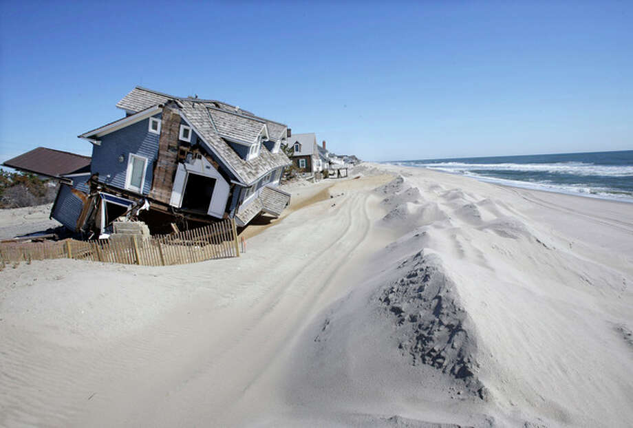 Homes severely damaged last October by Superstorm Sandy, are seen along the beach Thursday, April 25, 2013, in Mantoloking, N.J. Six months after Sandy devastated the Jersey shore and New York City and pounded coastal areas of New England, the region is dealing with a slow and frustrating, yet often hopeful, recovery. (AP Photo/Mel Evans) / AP