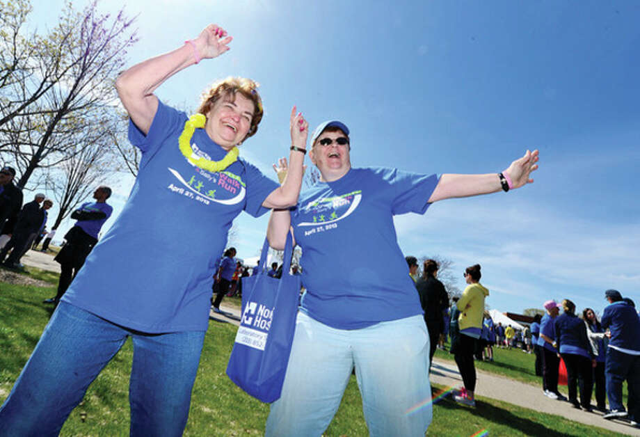 Hour photos / Erik TrautmannCancer survivor Deidre Panella and Diane Gagne dance to the sounds of the DNR Band at the 10th annual Whittingham Walk and Sally's Run at Calf Pasture Beach Saturday. / (C)2013, The Hour Newspapers, all rights reserved