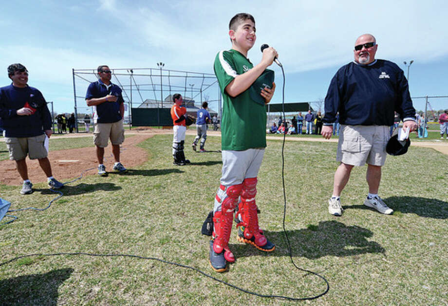 Hour photo/Erik TrautmannAlex Caneveri leads the Pledge of Allegiance during Norwalk Little League's opening day Saturday at Vets Park. / (C)2013, The Hour Newspapers, all rights reserved