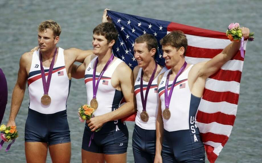 U.S. rowers, from right, Scott Gault, Charles Cole, Henrik Rummel and Glenn Ochal celebrate after winning the bronze medal for the men's rowing four in Eton Dorney, near Windsor, at the 2012 Summer Olympics, Saturday, Aug. 4, 2012. (AP Photo/Chris Carlson)
