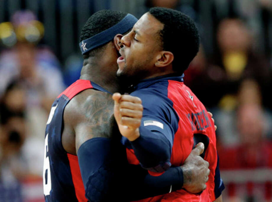 USA's Lebron James, left, and USA's Andre Iguodala, right, celebrate during a preliminary men's basketball game against Lithuania at the 2012 Summer Olympics, Saturday, Aug. 4, 2012, in London. (AP Photo/Eric Gay) / AP