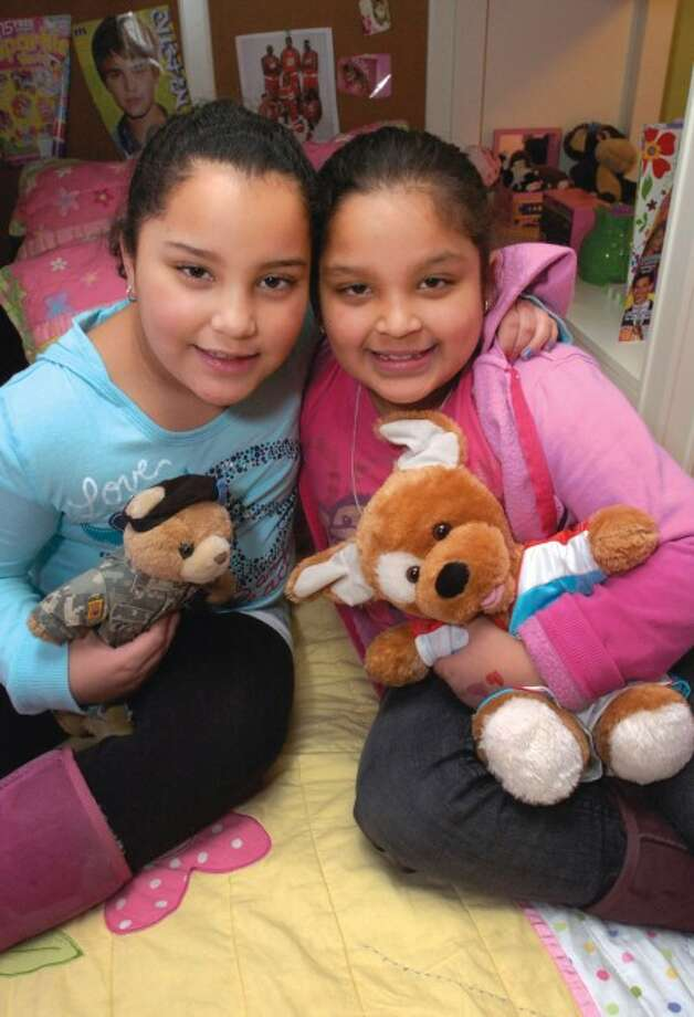 Cecilia and Isabela Montero, 8, of Norwalk. The twins mother believes that children should be children and will keep the girls from wearing makeup and adult clothing until their 16. In Peggy Orenstein