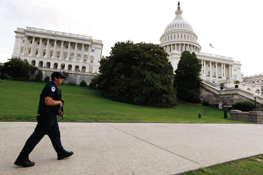 a U.S. Capitol Police officer patrols the grounds of the U.S. Capitol Saturday, Sept. 10, 2011, ahead of the 10th anniversary in Washington of the Sept. 11 attacks. (AP Photo/Jose Luis Magana) / FR159526 AP