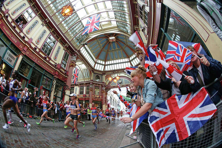 Runners pass through the historic landmark of Leadenhall Market in London during the women's marathon at the 2012 Summer Olympics on Sunday, Aug. 5, 2012. (AP Photo/Julien Behal, PA) UNITED KINGDOM OUT; NO SALES; NO ARCHIVE / PA