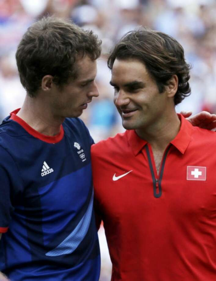 Britain's Andy Murray, left, talks with Switzerland's Roger Federer after the men's singles gold medal match at the All England Lawn Tennis Club at Wimbledon, in London, at the 2012 Summer Olympics, Sunday, Aug. 5, 2012. Murray won the gold medal. (AP Photo/Victor R. Caivano)