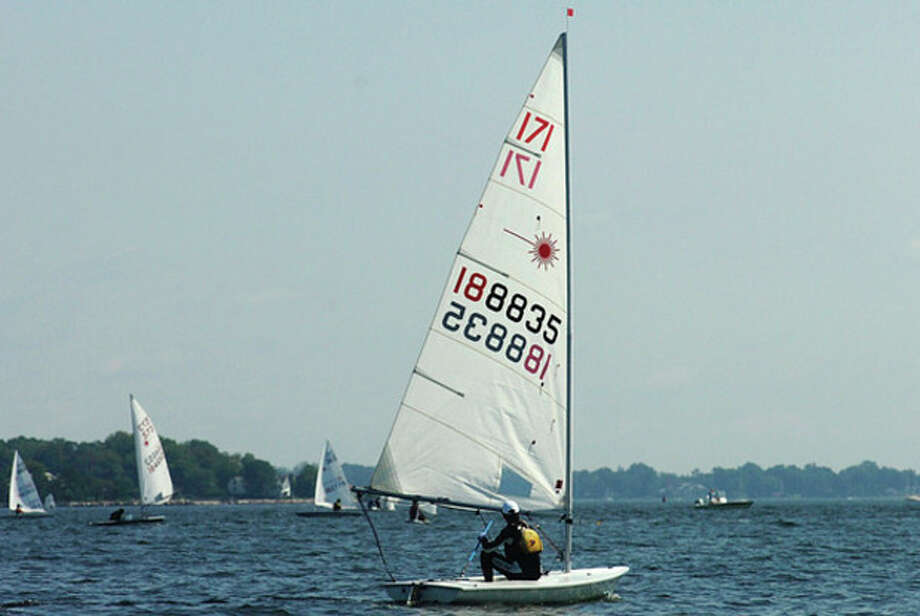John LaBossiere of Stamford Yacht Club competes in the Laser class of the Junior Saling Association Championships at Stamford Yacht Club Wednesday. / (C)2011, The Hour Newspapers, all rights reserved