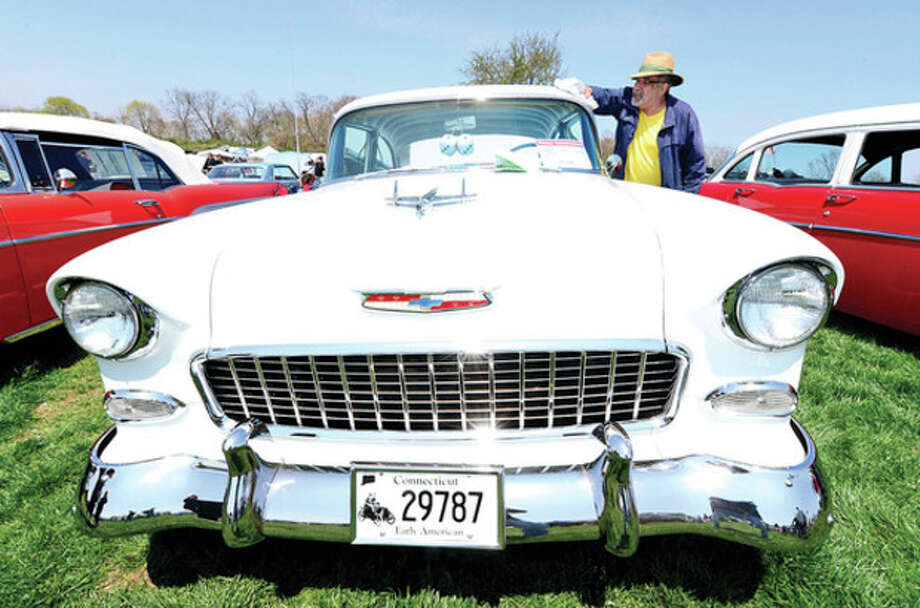 Jim Vega polishes his 1955 Chevy Bel Air at the Exchange Club's Antique Auto Show where 500 to 600 cars were exhibited at Taylor Farm in Norwalk Sunday. The cars ages range from pre 1915 to 1972.Hour photo / Erik Trautmann / (C)2013, The Hour Newspapers, all rights reserved