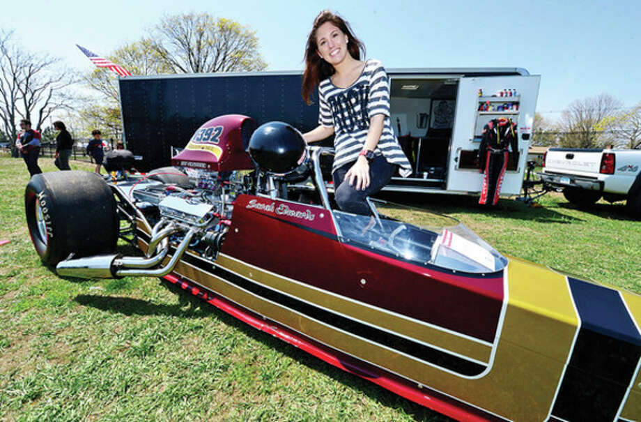 Hour photo / Erik TrautmannDrag car racer and Norwalk Community Collge student Sarah Edwards was on hand at the Exchange Club's Antique Auto Show where 500 to 600 cars were exhibited at Taylor Farm in Norwalk Sunday. The cars ages range from pre 1915 to 1972. / (C)2013, The Hour Newspapers, all rights reserved