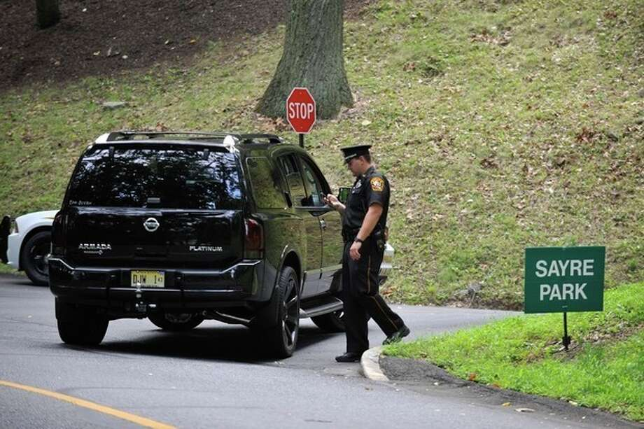 Lehigh University campus police block off a road leading to the Sayre Park dorms that house Philadelphia Eagles players and support staff, Sunday, Aug. 5, 2012, in Bethlehem, Pa. Garrett Reid, son of Eagles coach Andy Reid, was found dead in his dorm room early Sunday morning. (AP Photo/Chris Post) / FR170581 AP