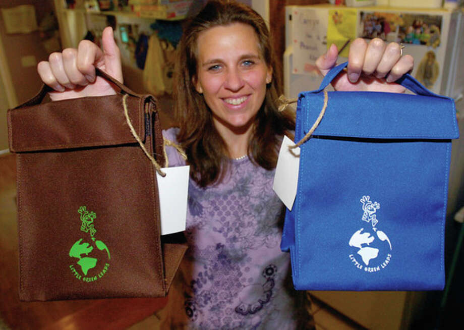 "Hour photo / Erik Trautmann Dawn Monteiro, owner of Little Leapers Daycare, is selling a ""green"" alternative to lunch bags in a new business venture, Little Green Leaps. / (C)2011, The Hour Newspapers, all rights reserved"