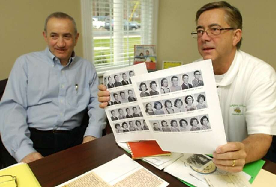 Members of the Honeyhill Elementary School Reunion committee, Vin Constabile and Peter Rockholz look over memorabilia from their old school. Hour photo / Erik Trautmann