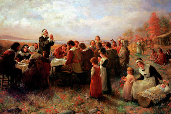 "FILE - This Tuesday, Nov. 15, 2005 photo shows a detail of the 1914 Jennie Brownscombe painting ""The First Thanksgiving at Plymouth"" hanging at the Pilgrim Hall Museum in Plymouth, Mass. The painting is labeled at the museum as being historically inaccurate, noting that the clothes are incorrect, and there were no log cabins in Plymouth in the early 17th century. New England is a region defined by its compact geography, its culture and its ""sense of place,"" as Harvard history professor Laurel Thatcher Ulrich put it. ""The mystique that has grown up over the centuries, perpetuated by the invention of celebrations like the 'First Thanksgiving' and all the images associated with the Revolution,"" she said, ""convinced people that there really was something called New England and that it mattered."" (AP Photo/Pilgrim Hall Museum, File)"