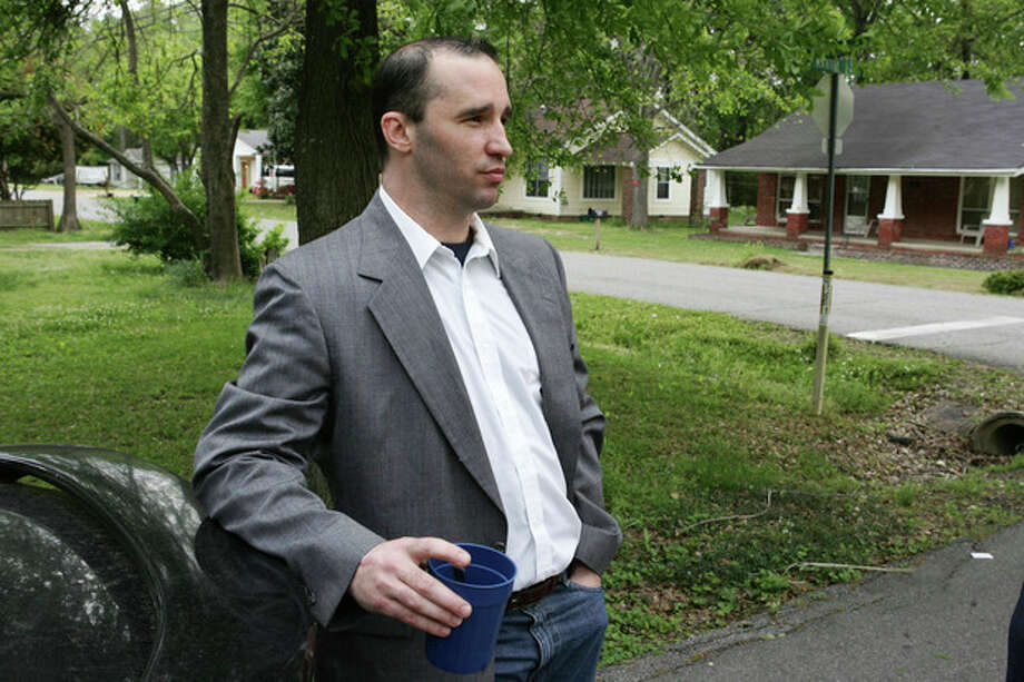 FILE - In this Tuesday April 23, 2013 file photo, Everett Dutschke stands in the street near his home in Tupelo, Miss., and waits for the FBI to arrive and search his home in connection with the sending of poisoned letters to President Barack Obama and others. FBI spokeswoman Deborah Madden says Dutschke, 41, was arrested Saturday, April 27, 2013, at his Tupelo home in connection with the letters, which allegedly contained ricin. They were sent last week to Obama, Sen. Roger Wicker of Mississippi and earlier to 80-year-old Mississippi Judge Sadie Holland. (AP Photo/Northeast Mississippi Daily Journal, Thomas Wells, File) MANDATORY CREDIT / The Northeast Mississippi Daily Journal