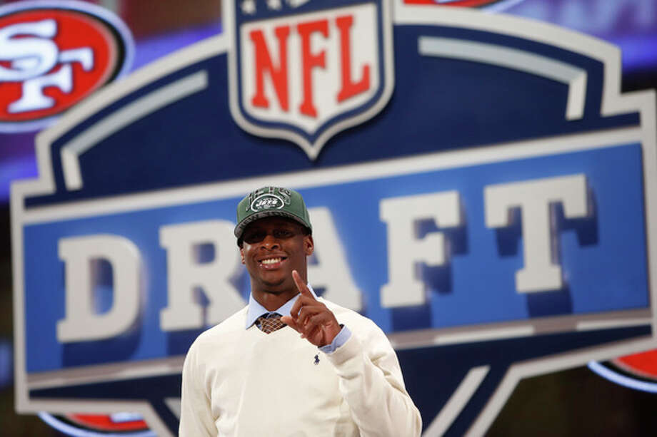 Geno Smith, a quarterback from West Virginia gestures after being selected 39th overall by the New York Jets in the second round of the NFL Draft, Friday, April 26, 2013 at Radio City Music Hall in New York., Friday, April 26, 2013 at Radio City Music Hall in New York. (AP Photo/Jason DeCrow) / FR103966 AP