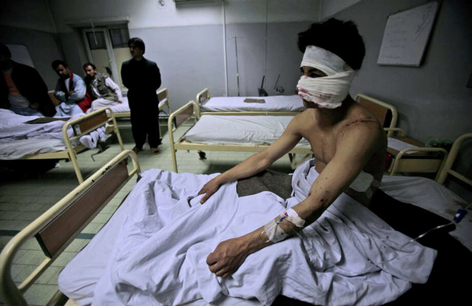 Afghan Ahmad Fawad, 20, who was injured in a suicide car bomber, sits in a hospital bed after receiving treatment, in Kabul, Afghanistan, Saturday, Oct. 29, 2011. A suicide car bomber struck a NATO convoy on the outskirts of Kabul on Saturday, a U.S. official says all 13 NATO service members killed in a suicide bombing in the Afghan capital were American troops. The Taliban claimed responsibility for the attack, which also killed four Afghans, including a policeman. (AP Photo/Muhammed Muheisen) / AP