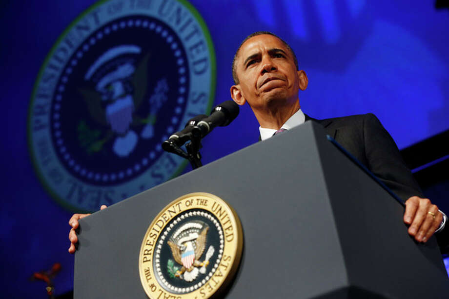 President Barack Obama pauses while speaking at the 2013 Planned Parenthood National Conference in Washington, Friday, April 26, 2013. (AP Photo/Charles Dharapak) / AP