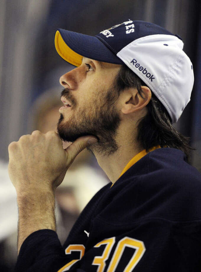 Buffalo Sabres goaltender Ryan Miller looks out from the bench before an NHL hockey game against the New York Islanders in Buffalo, N.Y., Friday, April 26, 2013. (AP Photo/Gary Wiepert)