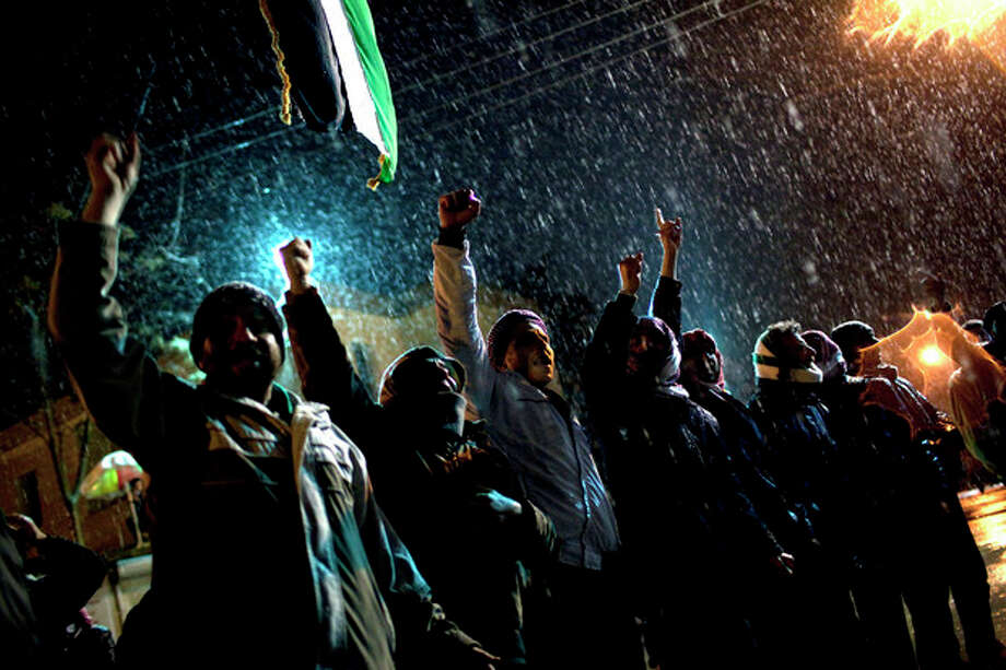 Free Syrian Army supporters chant anti government slogans under snowfall on the outskirts of Idlib , north Syria, Wednesday, Feb. 29, 2012. (AP Photo/Rodrigo Abd) / AP