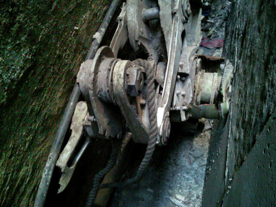 This Friday, April 26, 2013, photo provided by the New York City Police Department shows a piece of landing gear that authorities believe belongs to one of the airliners that crashed into the World Trade Center on Sept. 11, 2001, that was found wedged between a mosque and another building, in New York. Police say the medical examiner's office will complete a health and safety evaluation to determine whether to sift the soil around the buildings for possible human remains. (AP Photo/New York City Police Department) / NYPD
