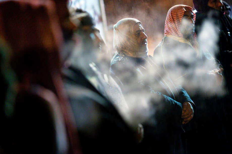 Free Syrian Army supporters gather for a protest under snowfall on the outskirts of Idlib , north Syria, Wednesday, Feb. 29, 2012. (AP Photo/Rodrigo Abd) / AP
