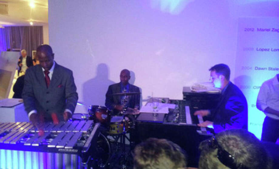 Contributed photoGerald Myles, Damon Grant, & Darby Wolf playing at an Olympic event.