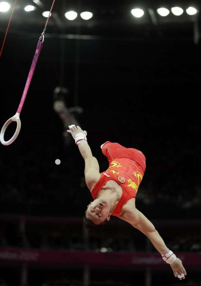 Silver medallist China's Chen Yibing performs on the rings during the artistic gymnastics men's apparatus finals at the 2012 Summer Olympics, Monday, Aug. 6, 2012, in London. (AP Photo/Gregory Bull)