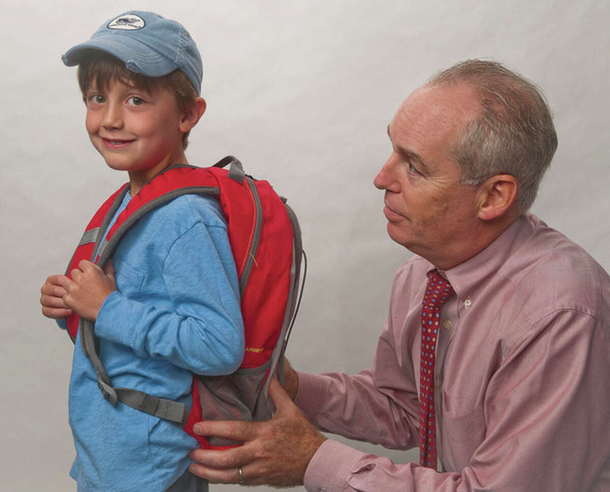 Contributed photo / Jeff Scholl, Norwalk Hospital According to Michael R. Marks, MD, spokesperson for the American Academy of Orthopaedic Surgeons, this boy's backpack is well-sized and fits appropriately. It is very important to avoid back problems by wearing and packing backpacks properly.