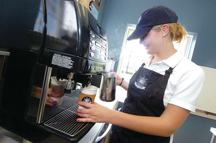 Hour Photo/ Alex von Kleydorff. Lindsay Wrinn makes a Cappuccino at Captains Cup at Norwalks Cove Marina / 2012 The Hour Newspapers