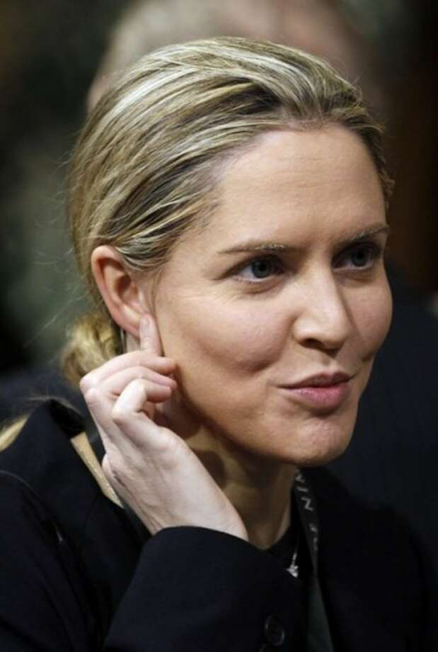 FILE - This is a May 9, 2012 file photo of British Member of Parliament Louise Mensch. Mensch said Monday Aug. 6, 2012 that she is quitting the House of Commons to move to the United States with her family. Louise Mensch, elected in 2010 as a member of the governing Conservative Party after a career as the author of racy novels, said Monday she planned to leave Britain and move to New York. (AP Photo/Stefan Wermouth/PA, File)