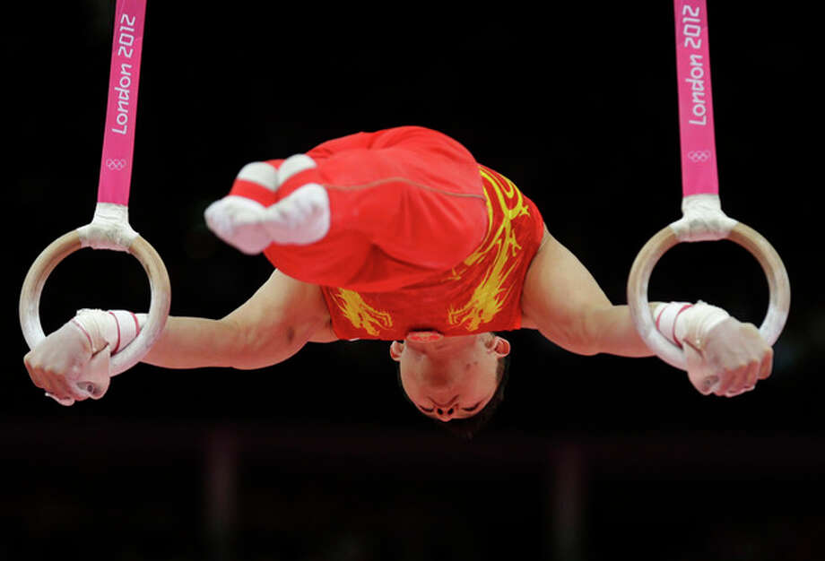 Chinese gymnast Chen Yibing performs on the rings during the artistic gymnastics men's apparatus finals at the 2012 Summer Olympics, Monday, Aug. 6, 2012, in London. (AP Photo/Gregory Bull) / AP