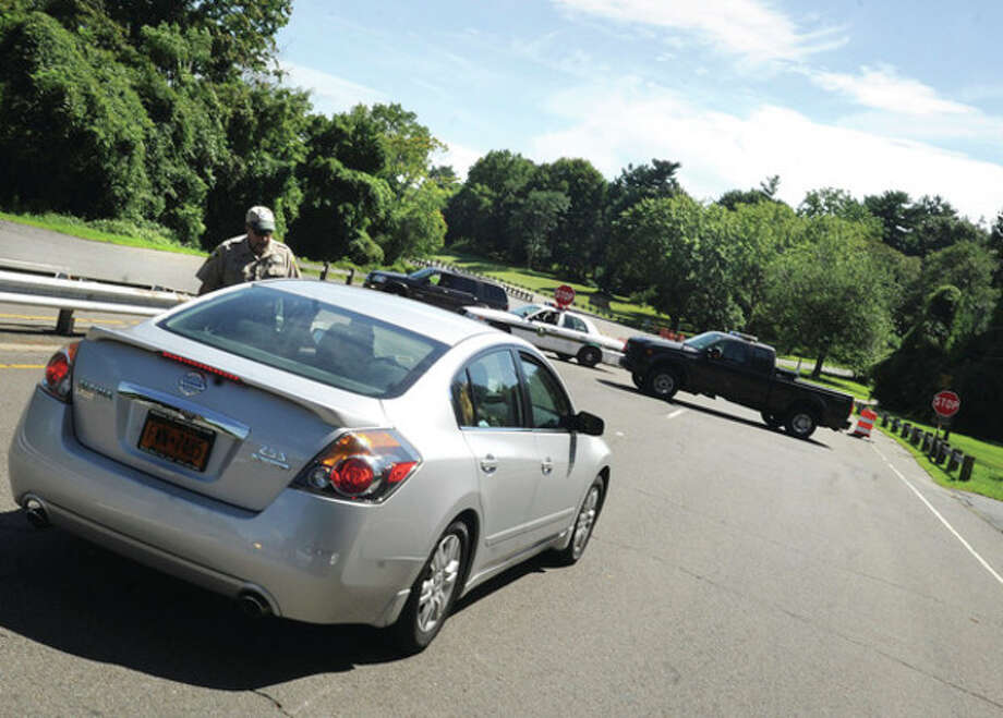 Police and security turn visiting cars away from Sherwood Island Park in Westport Monday in preparation President Obama who will be arriving. hour photo/matthew Vinci