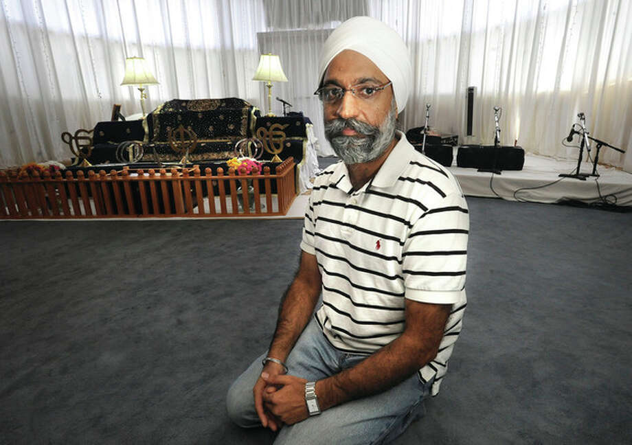 Hour photo / Matthew VinciPamma Singh Gulati, member of the GurdwaraSikh Temple in Norwalk, said members are inshock over the tragedy in Wisconsin.