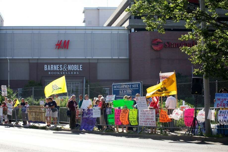 Tea Party protestors rally outside of the Stamford Marriott Monday afternoon where President Obama made an appearance. Hour Photo / Danielle Robinson