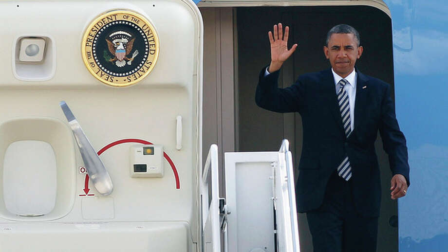 AP photo / Pablo Martinez MonsivaisPresident Barack Obama waves as he arrives at JFK International Airport on Air Force One in New York Monday. Obama was en route to Stamford and Westport to campaign during a pair of fundraising events expected to raise $2 million for the Obama Victory Fund. / AP