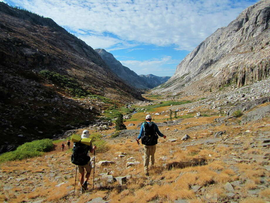 This Sept. 20, 2012 photo shows hikers making their way through an area of Yosemite National Park that lacks trails in Stubblefield Canyon. Outdoor adventurer Andrew Skurka, pictured on the right, has hiked tens of thousands of miles alone in wild areas across the U.S., and now shares his knowledge by leading guided trips for others interested in backcountry hikes. (AP Photo/John Pain) / AP