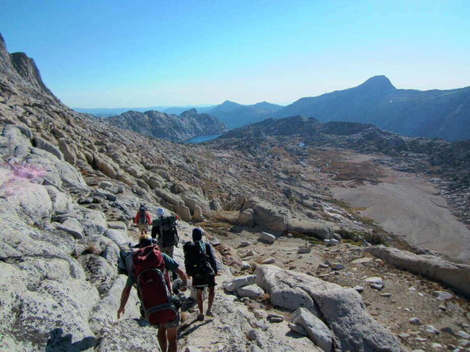 This Sept. 19, 2012 photo shows hikers on a guided backcountry trip in Yosemite National Park near Stubblefield Canyon. For hikers looking for a challenge, off-trail trips to the backcountry offer adventure and access to less crowded, pristine areas of the park. (AP Photo/John Pain) / AP