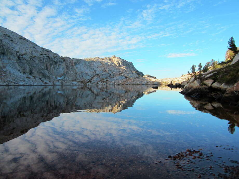 This Sept. 20, 2012 photo shows an unnamed lake in Yosemite National Park's backcountry. Getting off the park's extensive trail system means hikers can see pristine areas like this where fewer people pass through. (AP Photo/John Pain) / AP