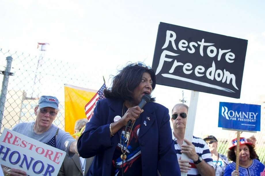 """Tea Party Speaker """"Barbara from Harlem"""" protests outside of the Stamford Marriott where President Obama made an appearance Monday afternoon. Hour Photo / Danielle Robinson"""