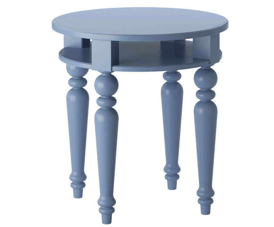 This publicity product photo provided by Ikea (www.ikea.com) shows a blue isala table. When King Gustav III visited France he brought back impressions of Neoclassical style. This Isala table is an example of how the style was interpreted with elegant restraint. (AP Photo/Ikea) / Ikea