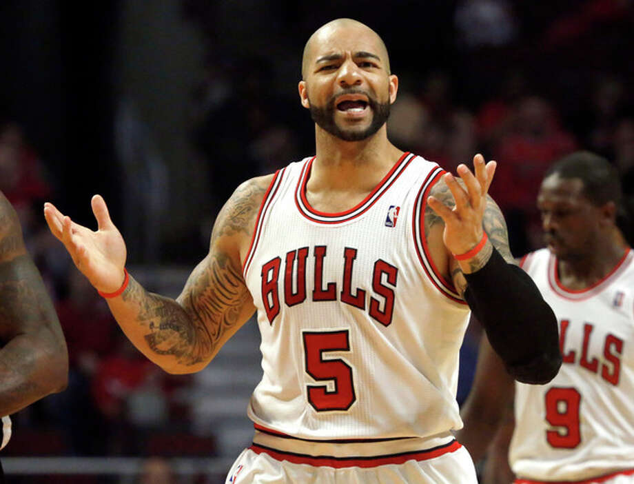 Chicago Bulls power forward Carlos Boozer complains to a referee about a call against him during the first half of Game 3 of their first-round NBA basketball playoff series against the Brooklyn Nets, Thursday, April 25, 2013, in Chicago. (AP Photo/Charles Rex Arbogast) / AP