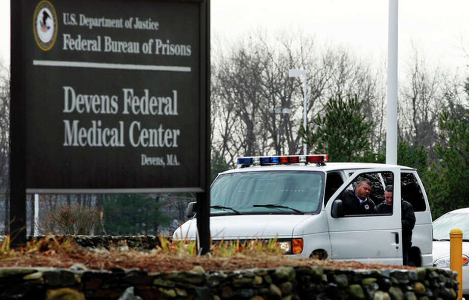 FILE - In this Dec. 5, 2011 file photo, two guards are stationed outside the Devens Federal Medical Center (FMC) in Devens, Mass. The U.S. Marshals Service said Friday, April 26, 2013, that Dzhokhar Tsarnaev, charged in the Boston Marathon bombing April 15, 2013, had been moved from a Boston hospital to the federal medical center at Devens, about 40 miles west of the city. (AP Photo/Elise Amendola, File) / AP