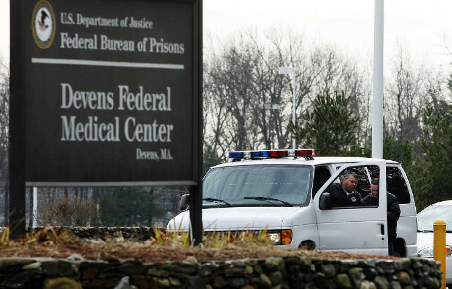 FILE - In this Dec. 5, 2011 file photo, two guards are stationed outside the Devens Federal Medical Center (FMC) in Devens, Mass. The U.S. Marshals Service said Friday, April 26, 2013, that Dzhokhar Tsarnaev, charged in the Boston Marathon bombing April 15, 2013, had been moved from a Boston hospital to the federal medical center at Devens, about 40 miles west of the city. (AP Photo/Elise Amendola, File)