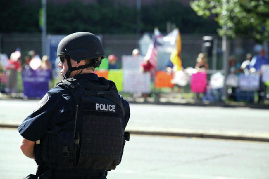 Hour photo / Danielle RobinsonA police officer stands guard outside of the Stamford Marriott Monday afternoon where President Obama made an appearance.