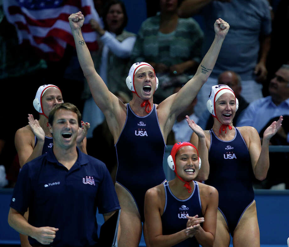 United States women's water polo athletes react to a goal against Australia during a women's semifinal water polo match at the 2012 Summer Olympics, Tuesday, Aug. 7, 2012, in London. (AP Photo/Julio Cortez) / AP