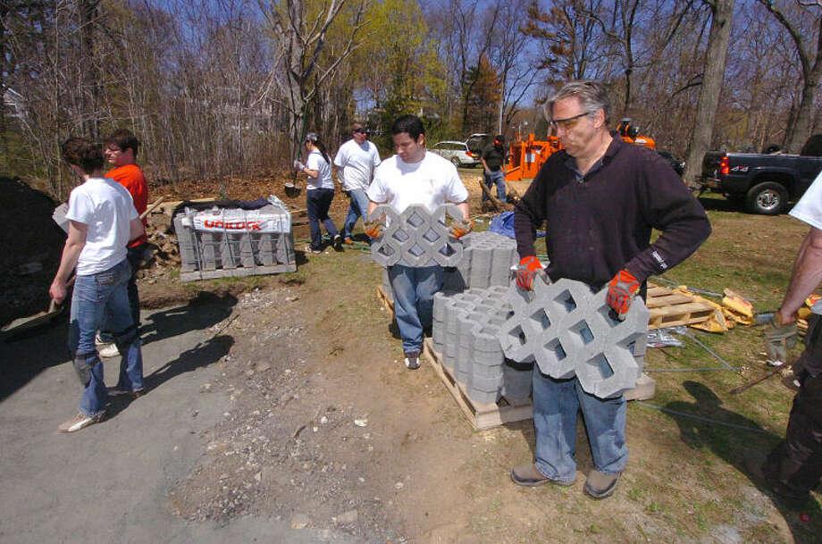 Hour Photo/Alex von Kleydorff Work at Farm Creek Preserve by Diageo employees