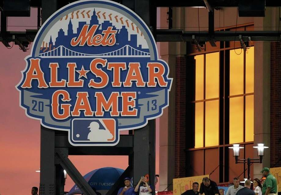 A colorful sunset is reflected in the windows near the 2013 All-Star Game logo during the New York Mets' baseball game against the Miami Marlins at Citi Field in New York, Tuesday, Aug. 7, 2012. (AP Photo/Kathy Willens) / AP