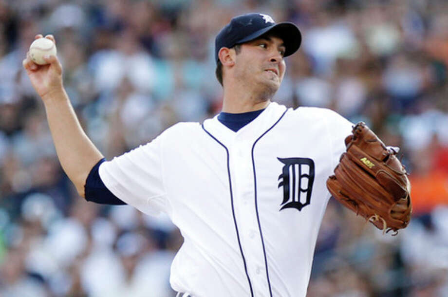 Detroit Tigers starter Rick Porcello pitches against the New York Yankees in the first inning of a baseball game Tuesday, Aug. 7, 2012, in Detroit. (AP Photo/Duane Burleson) / FR38952 AP