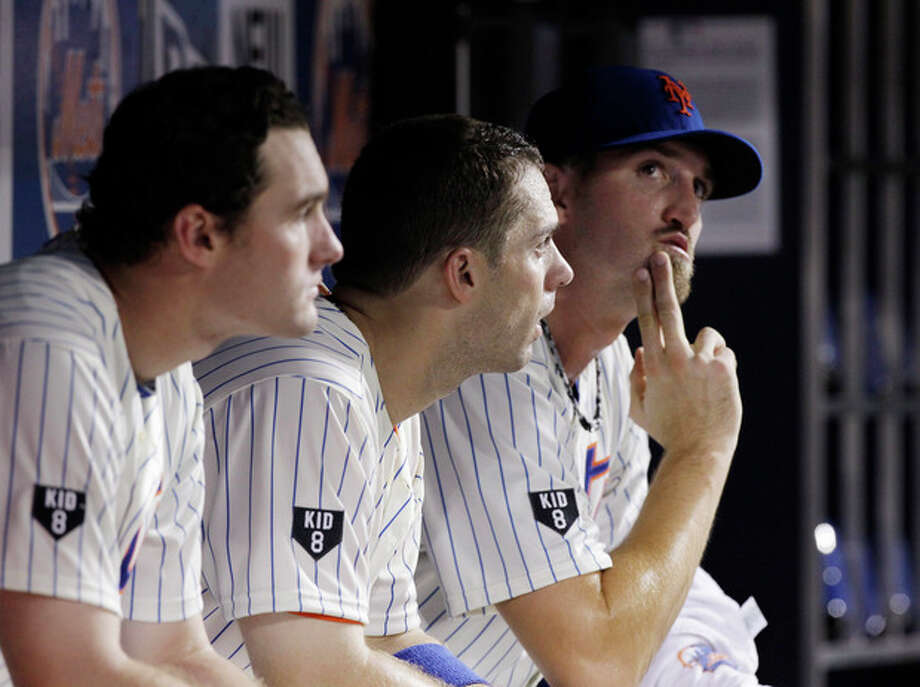 New York Mets' Daniel Murphy, left, David Wright, center, and starting pitcher Jonathon Niese sit in the dugout in the fifth inning against the Miami Marlins in a baseball game in New York, Tuesday, Aug. 7, 2012. (AP Photo/Kathy Willens) / AP