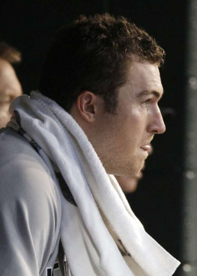 New York Yankees starting pitcher Phil Hughes sits in the dugout after being pulled in the fifth inning following a two-run double by Detroit Tigers' Miguel Cabrera in a baseball game Tuesday, Aug. 7, 2012, in Detroit. (AP Photo/Duane Burleson)